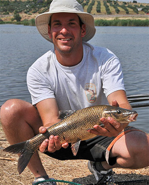 Top German Rene Bredereck with one of the few river barbel caught. While these species were present, they didn't run to any great size and a kilo fish was about the average caught.