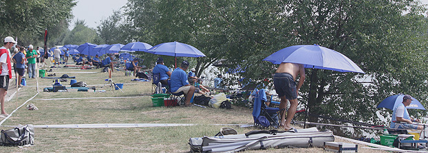 Brollies were a visible feature of the championships, for nearly everyone, due to the oppressive and humid heat.